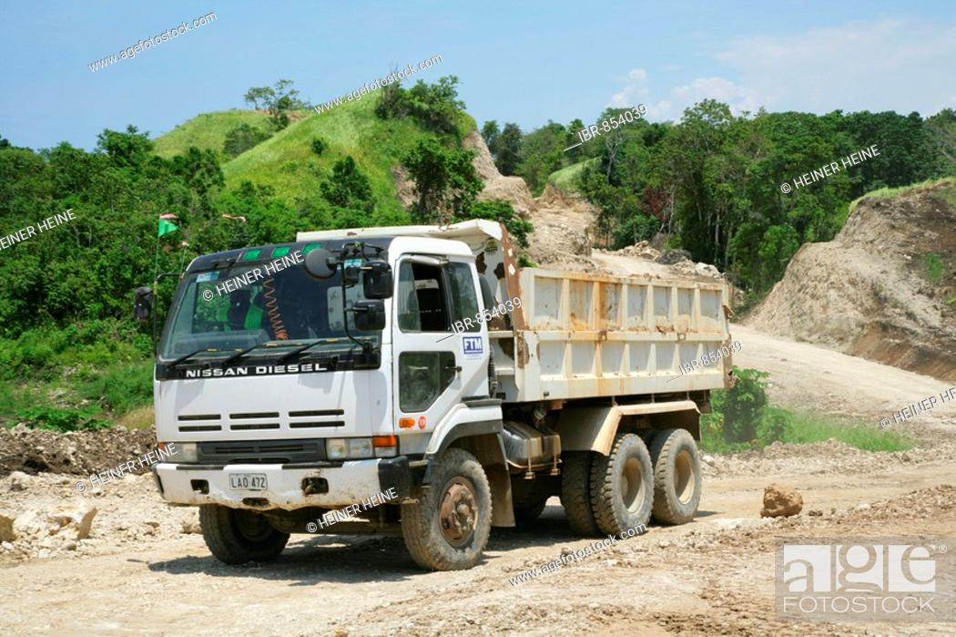 Stock Photo: Juggernaut during the building of a refinery and harbour area for the Ramu Nickel Mine, chinese mining company, Basamuk, Papua New Guinea, Melanesia.
