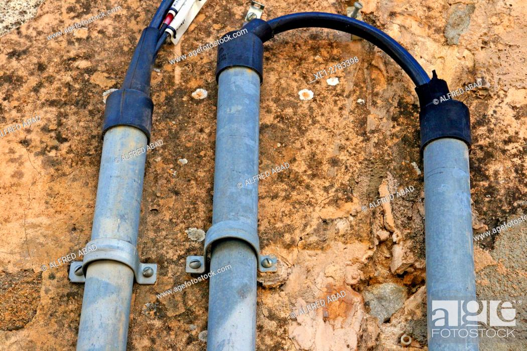 Stock Photo: Power wires and pipes.