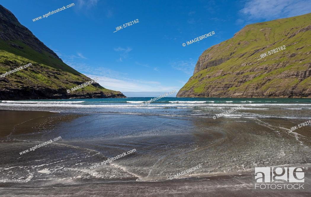 Stock Photo: Sandy beach beach in bay surrounded by steep mountains, Saksun, Streymoy, Faroe Islands, Føroyar, Denmark, Europe.