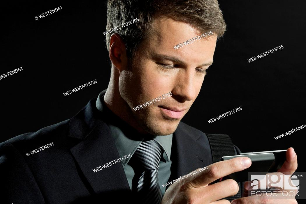 Stock Photo: Mid adult man using technical equipment, close up.