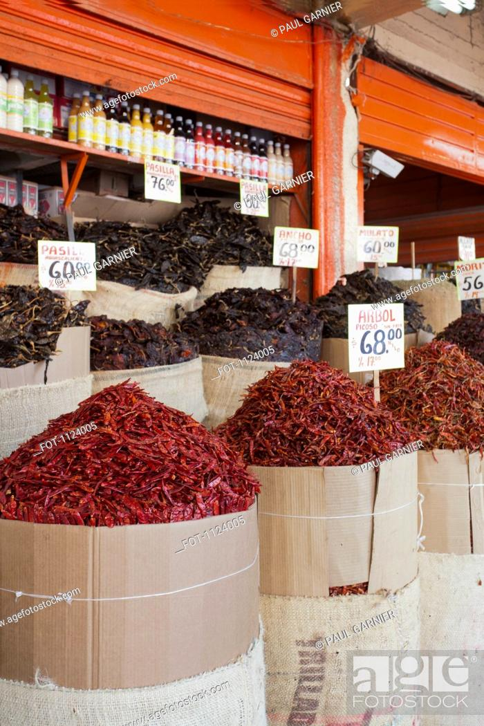 Stock Photo: Sacks of various dried chili peppers for sale at an Merced Market, Mexico City.