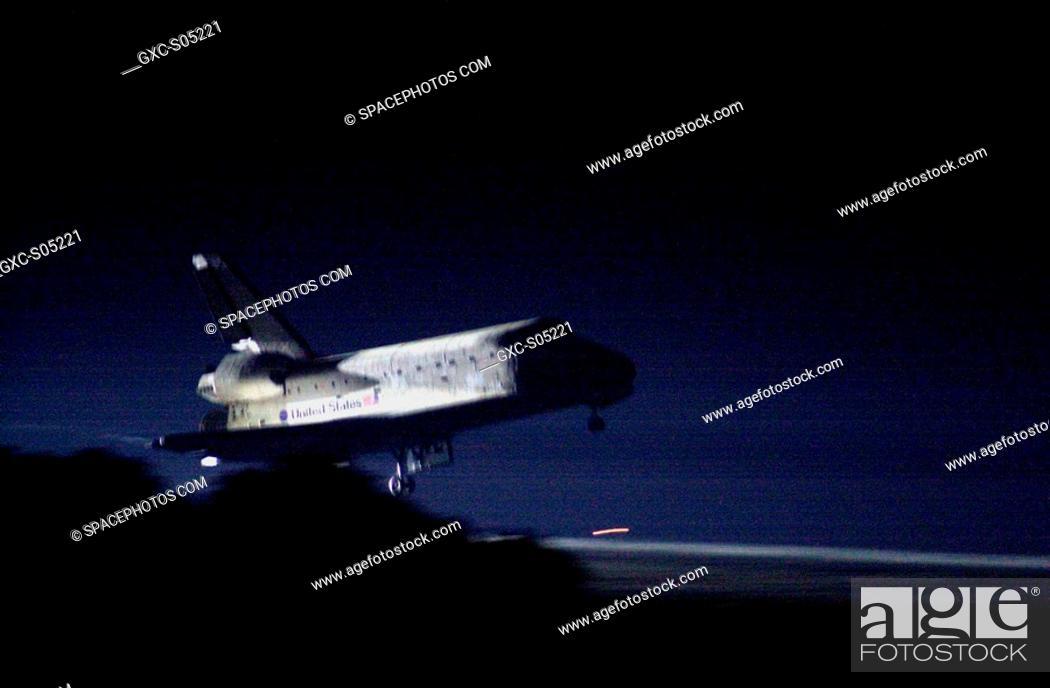 05/29/2000 -- Landing lights illuminate Space Shuttle Atlantis as it