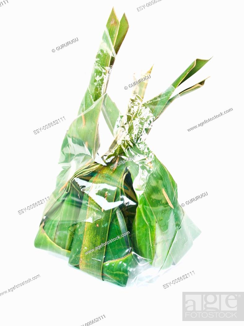 Stock Photo: Thai dessert packages made from banana leaves.