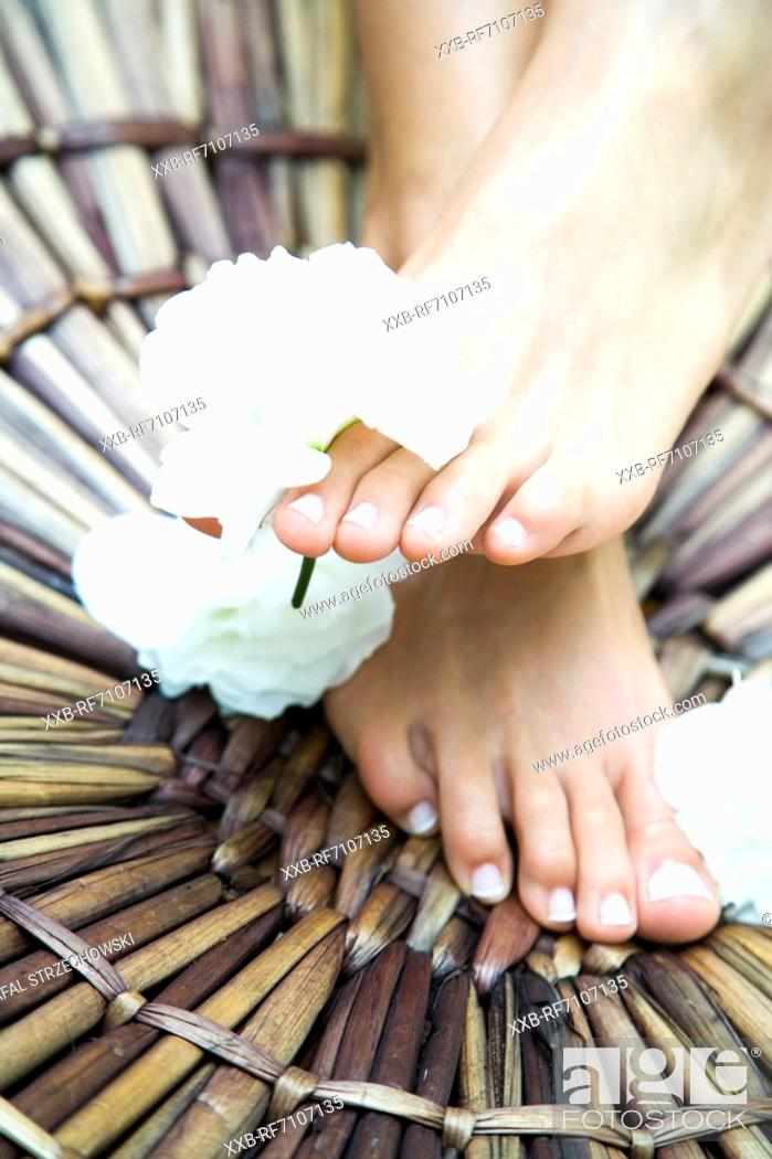 Stock Photo: Feet with flowers.