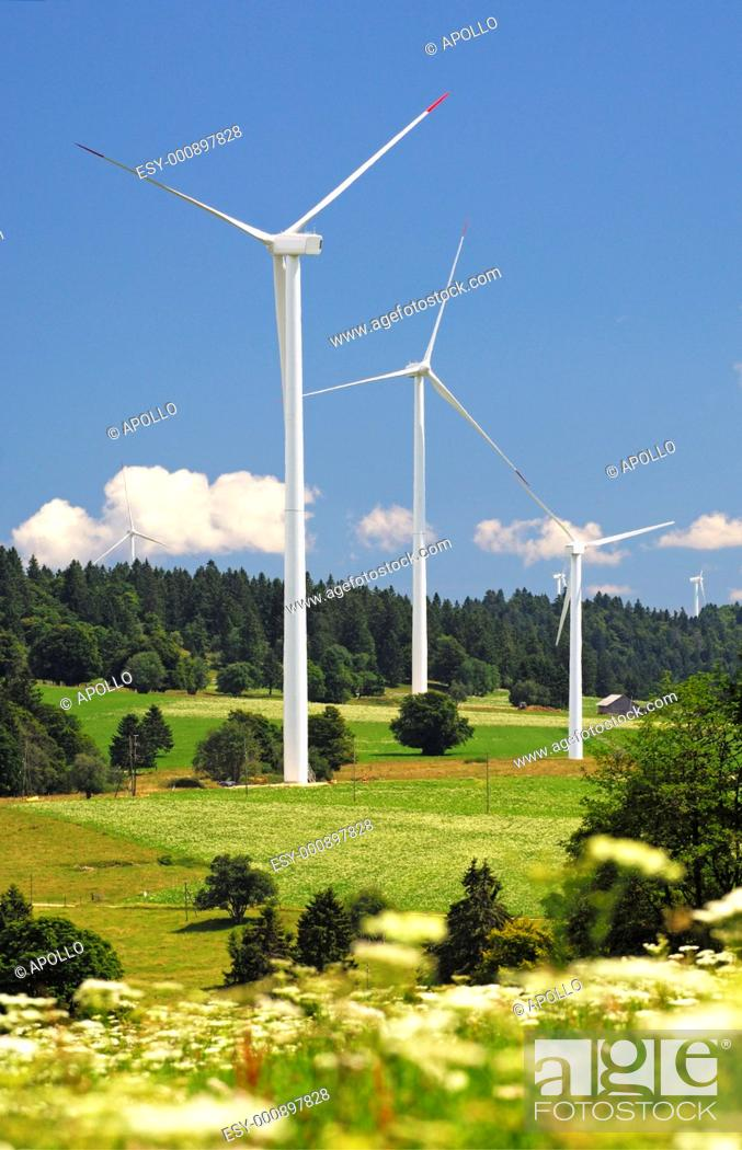 Stock Photo: Wind turbines for generating renewable wind power in a wind farm on Mont Crosin, canton of Jura, Switzerland.