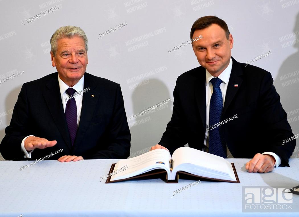 Stock Photo: German President Joachim Gauck (l) and Polish President Andrzej Duda sign the guest book during a visit to the multi-national corps North/East of the NATO in.