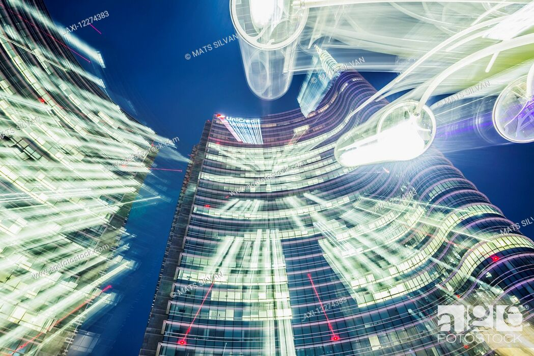 Stock Photo: Long exposure of lights and the Unicredit tower in the finance district; Milan, Lombardy, Italy.