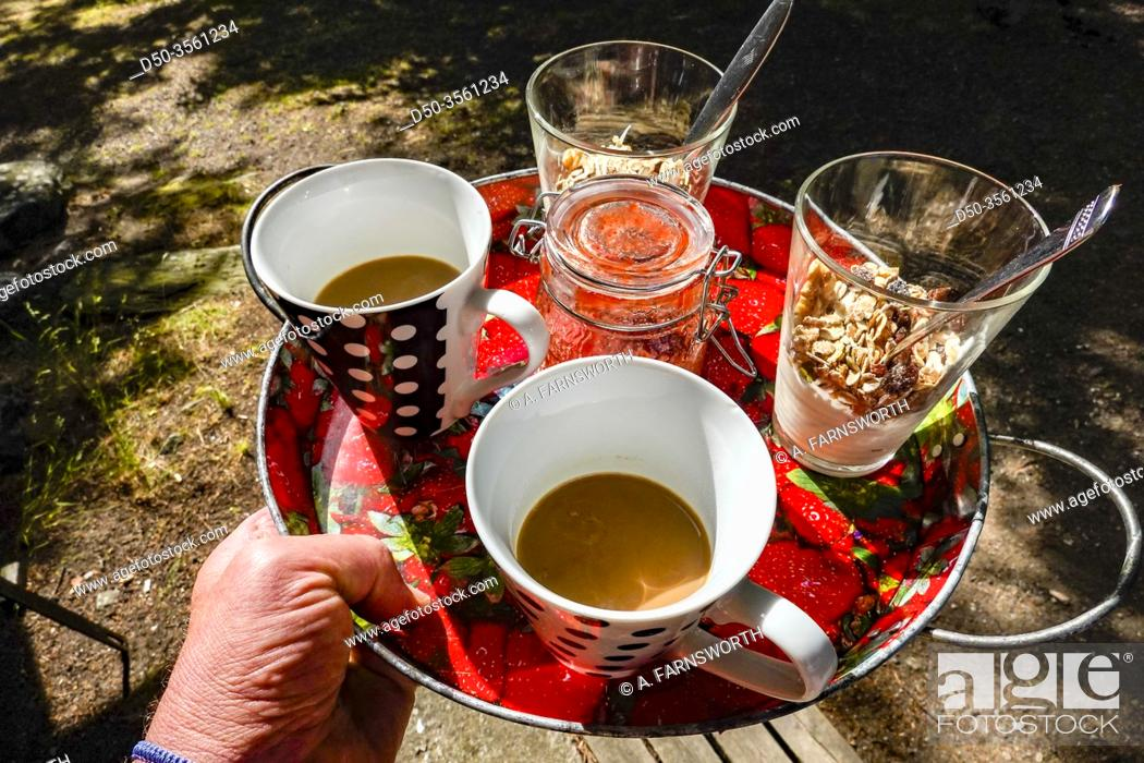 Imagen: Stockholm, Sweden Breakfast, musli, yogurt and coffee, for two served on a platter.