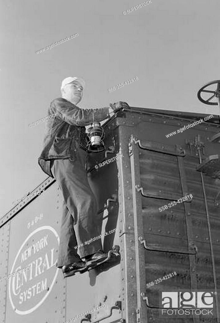 Stock Photo: Man inspecting train.