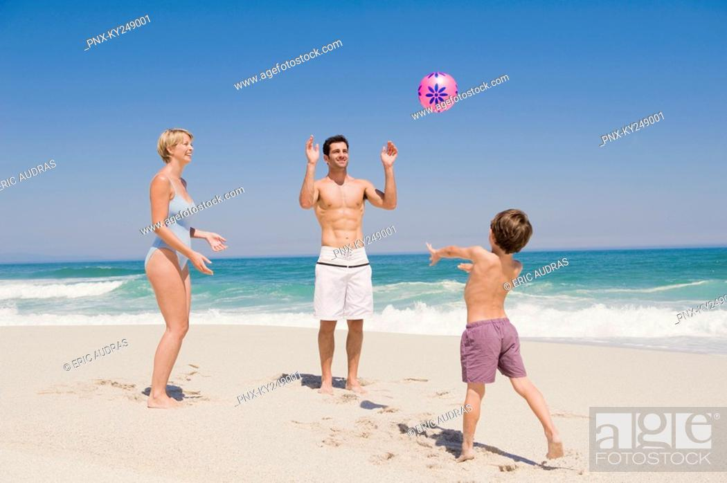 Stock Photo: Family playing with a beach ball.
