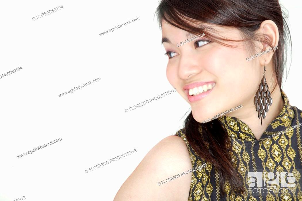Stock Photo: Woman indoors smiling and looking to side.