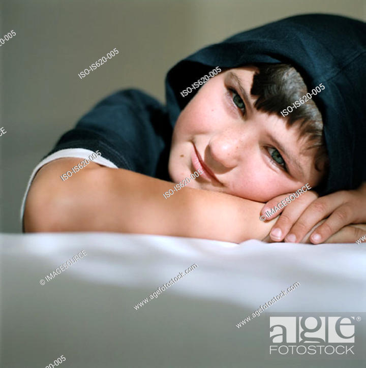 Stock Photo: Smiling boy wearing a hood.