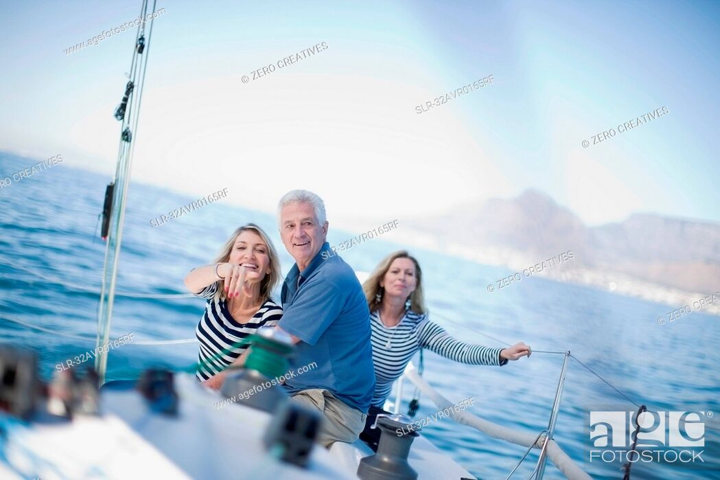 Stock Photo: Older people sitting together on boat.