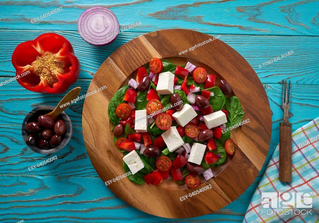 Stock Photo: Cheese salad with tomatoes spinach and kalamata olives.