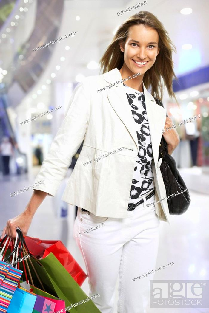 Stock Photo: Woman walking with shopping bags.