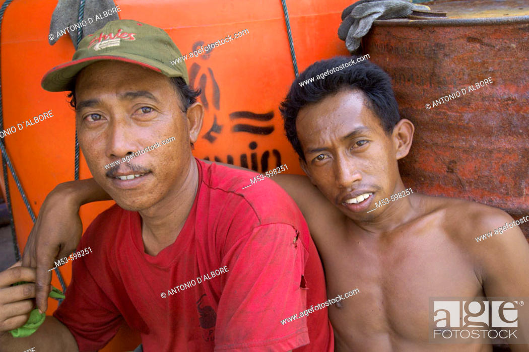 Stock Photo: two workers have a rest on a mercantile boat in muara angke fish market. jakarta north. indonesia. asia.