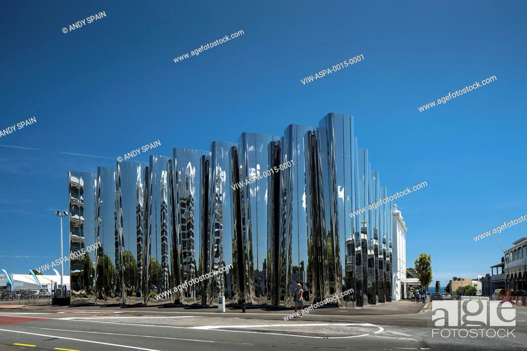 Stock Photo: View across street towards polished building facade. Len Lye Centre, New Plymouth, New Zealand. Architect: Patttersons Associates, 2015.