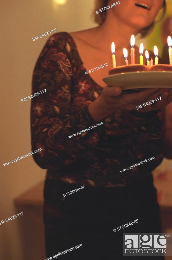 Stock Photo: Woman holding a Birthday Cake cropped.