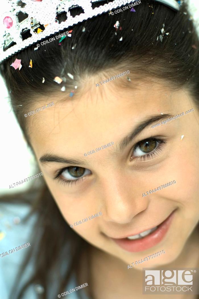 Stock Photo: Girl wearing tiara, smiling at camera, portrait.