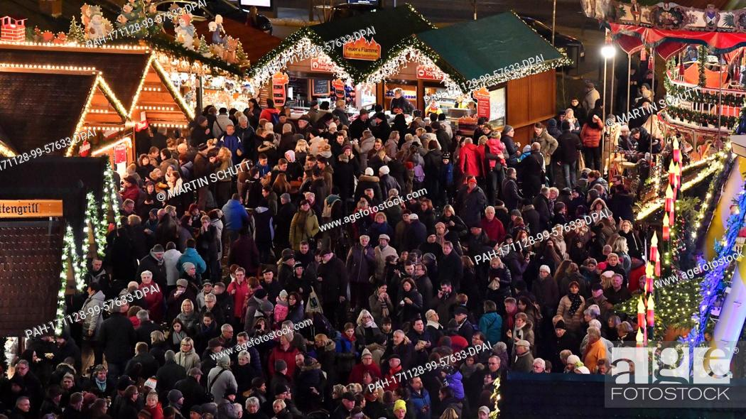 Stock Photo: The christmasmarket opens in Erfurt, Germany, 28 November 2017. Some 200 stand owners offer sweets, food, spices and handcrafted pieces in front of the medieval.