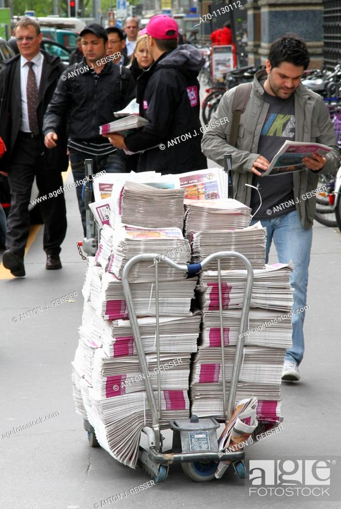Stock Photo: Blick am abend , free newspaper , zurich switzerland.