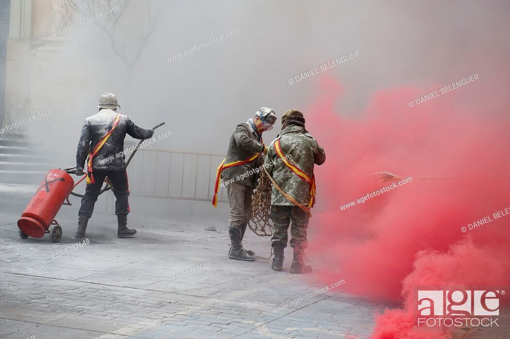Stock Photo: Festival called 'els enfarinats de Ibi', where men fighting with eggs and flour on the main square of Ibi, Alicante, Spain.
