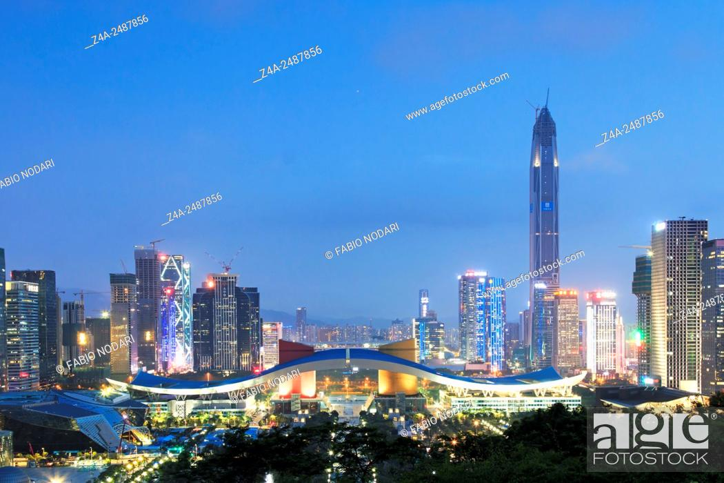 Stock Photo: Shenzhen, China - August 27, 2015: Shenzhen cityscape at dusk with the Civic Center and the Ping An IFC on foreground.