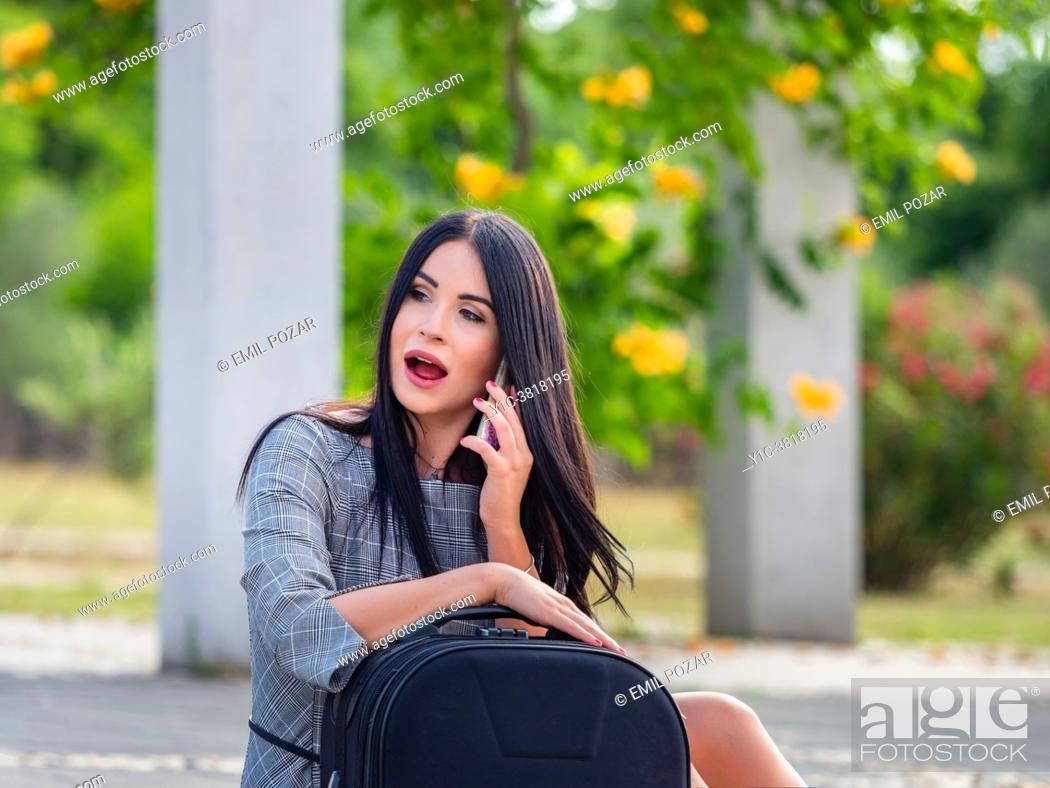 Stock Photo: Young woman sudden call.