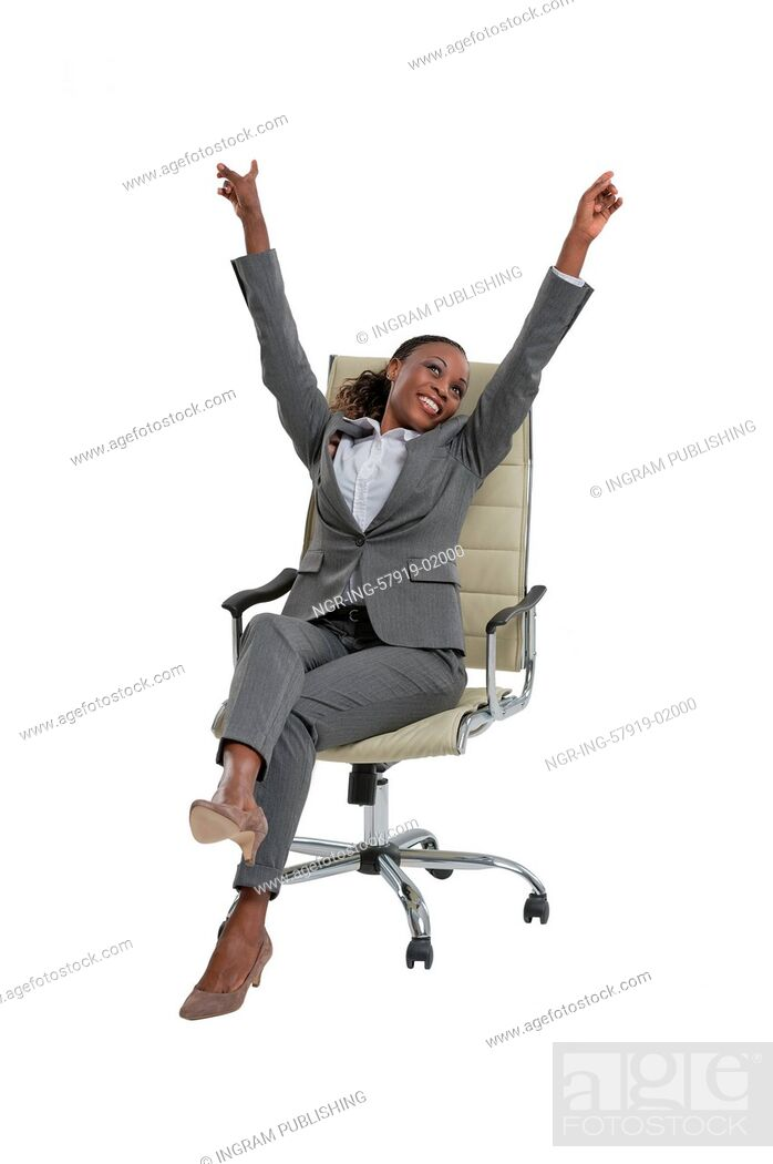 Stock Photo: Happy business woman sitting on chair, isolated over white background.