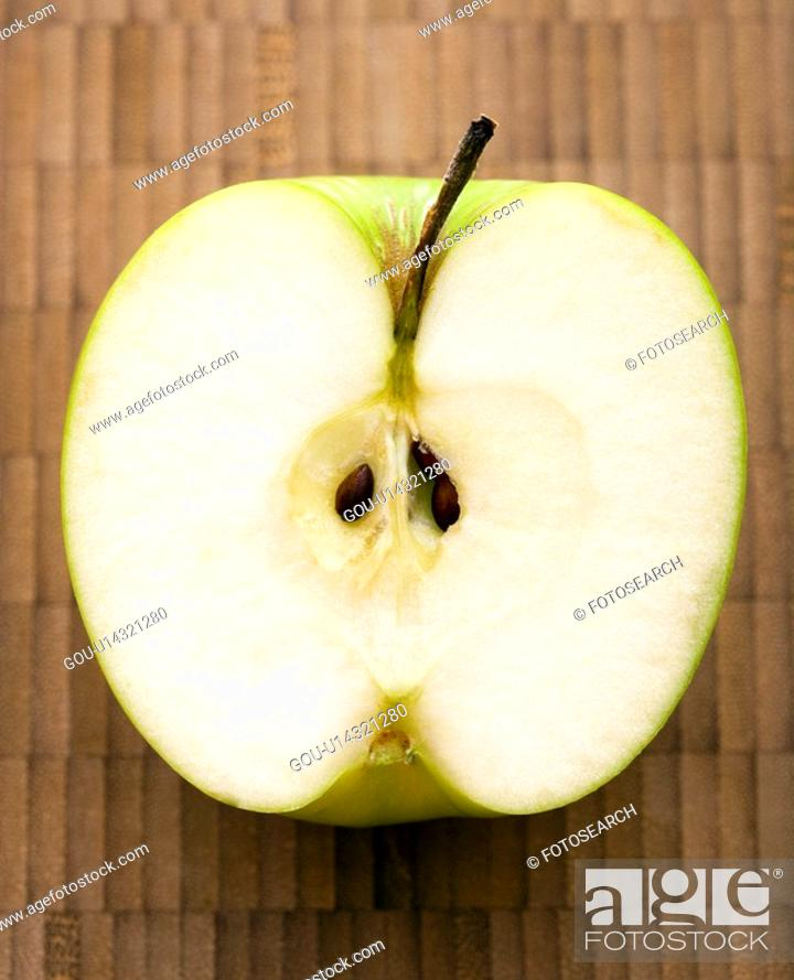 Stock Photo: Close up of sliced green apple.