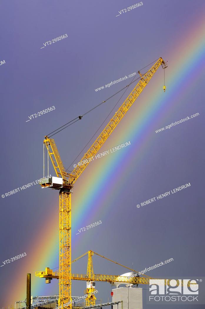 Stock Photo: Construction crane and rainbow, Hong Kong, China.