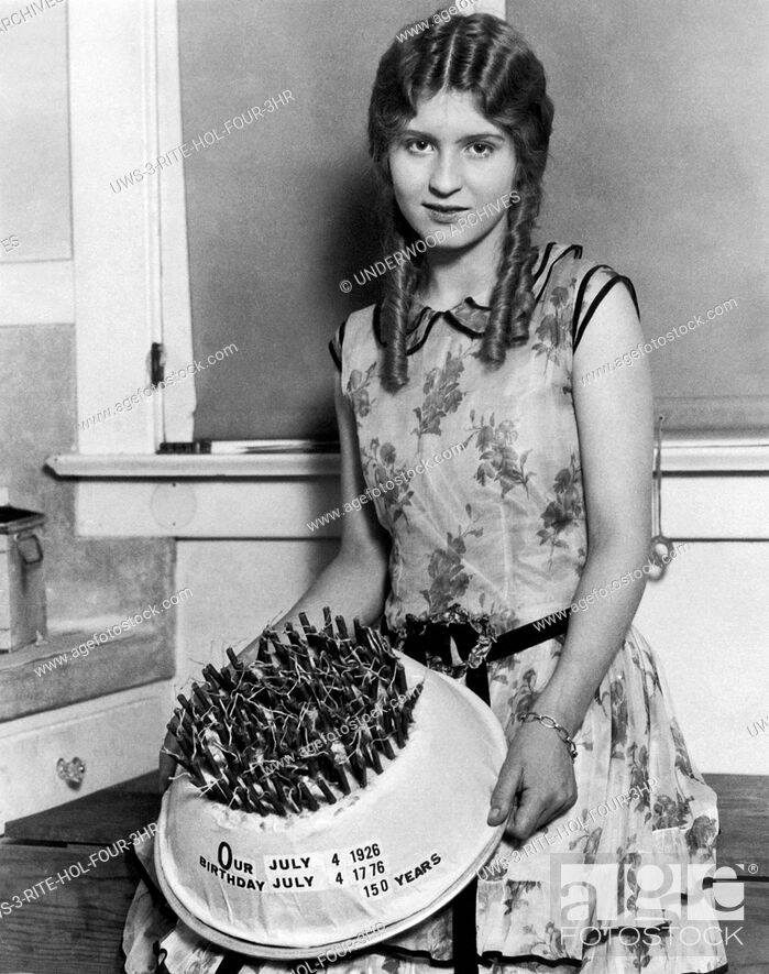Stock Photo: Los Angeles, California: July 4, 1926. A young woman with the special birthday cake she made in honor of the 150th birthday of the United States.