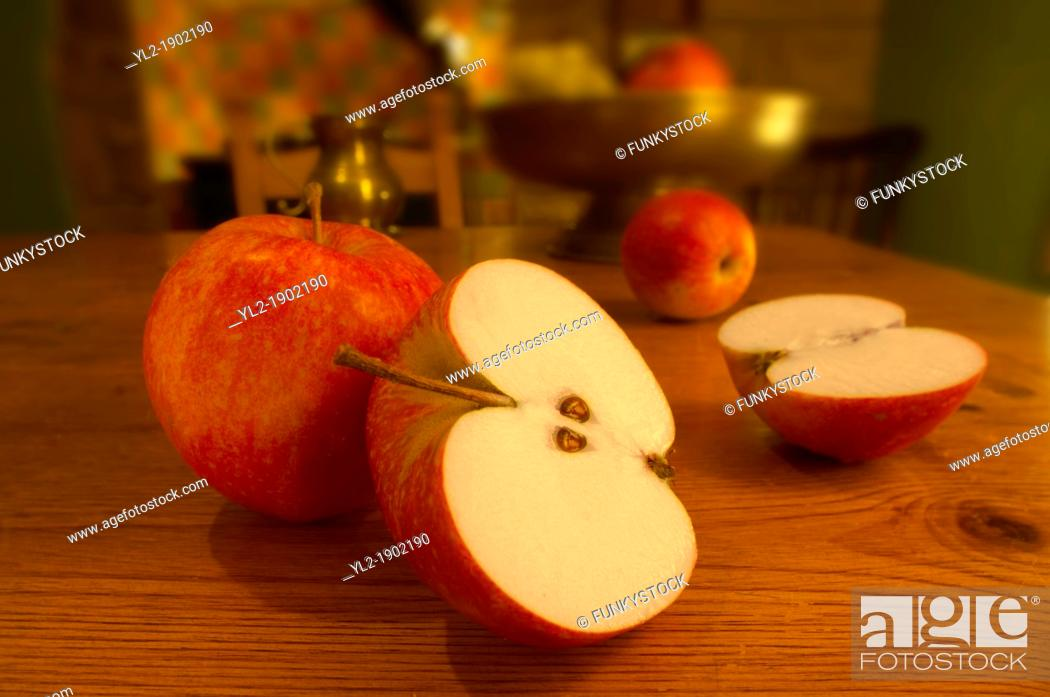Stock Photo: red apples on a country kitchen table.