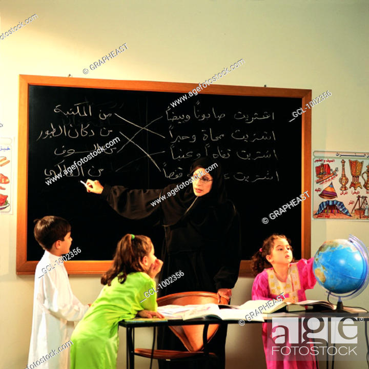 Stock Photo: Teacher and pupils in classroom.