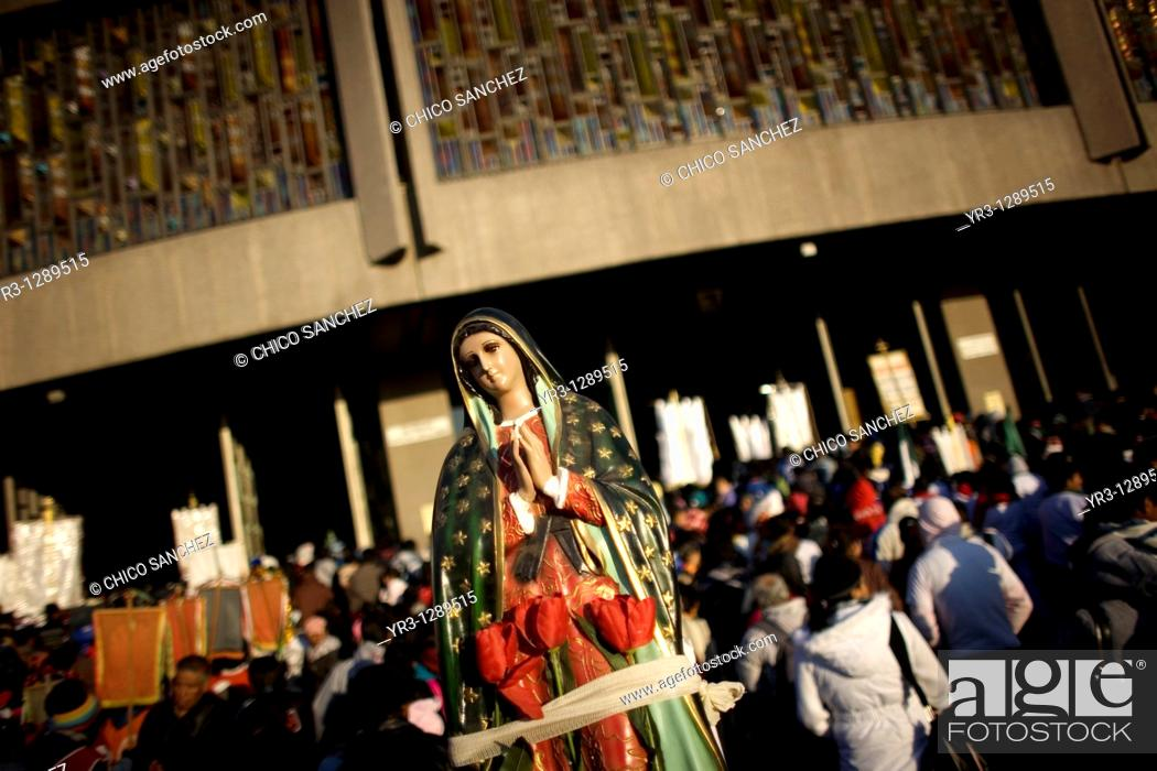 Stock Photo: A pilgrim carries a statue of the Our Lady of Guadalupe outside the Our Lady of Guadalupe Basilica in Mexico City, December 11.