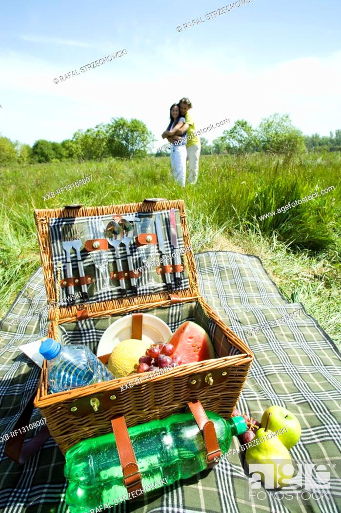 Stock Photo: couple having picnic.