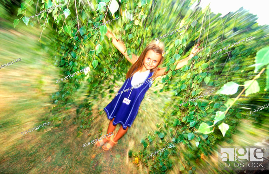 Stock Photo: A young girl in a park (blurred).