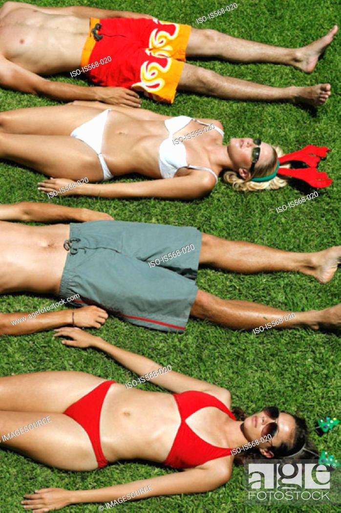 Stock Photo: Sunbathing in Xmas head decoration.