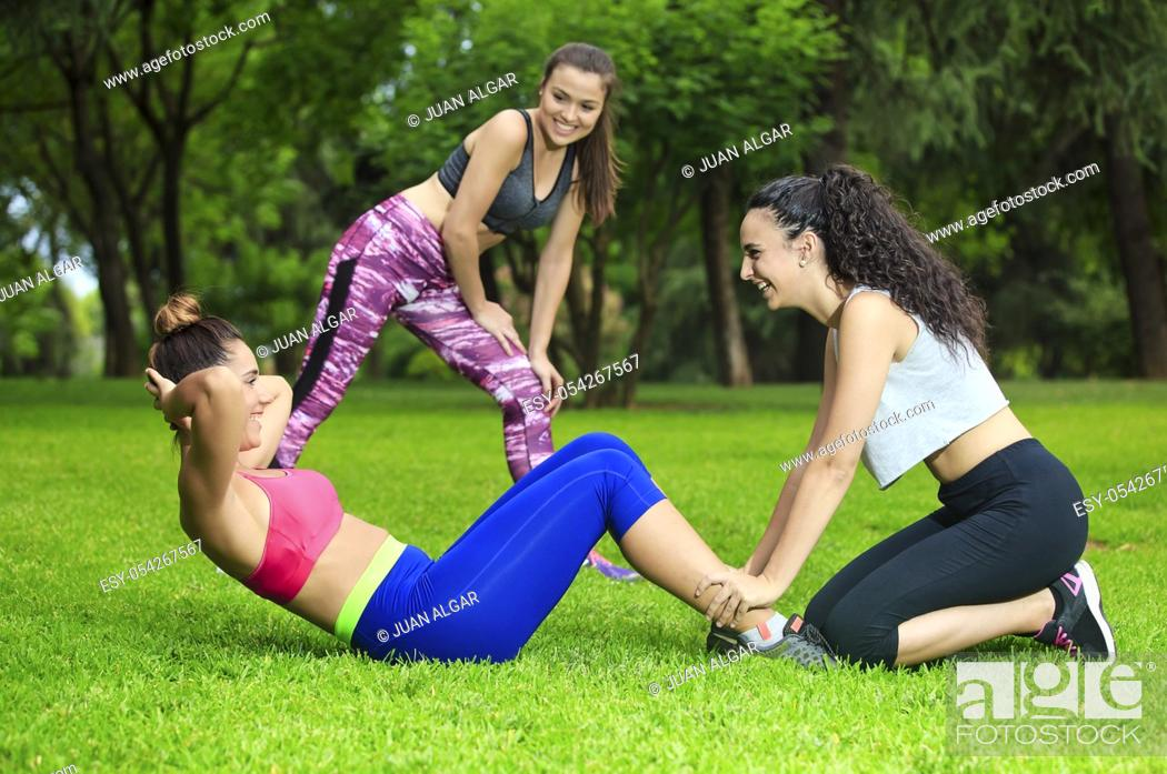 Stock Photo: Healthy friends training in park on grass.