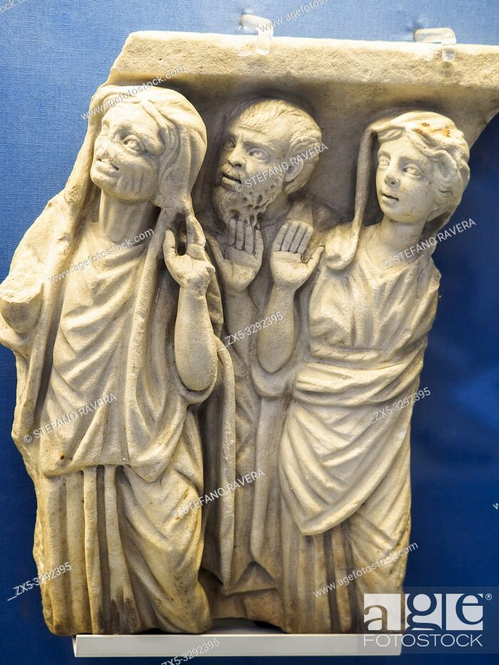 Imagen: Part of a marble sarchophagus: three worshippers in Greek dress. Roman about AD 250-70. The old woman is derived from Hellenistic Greek genre figures.