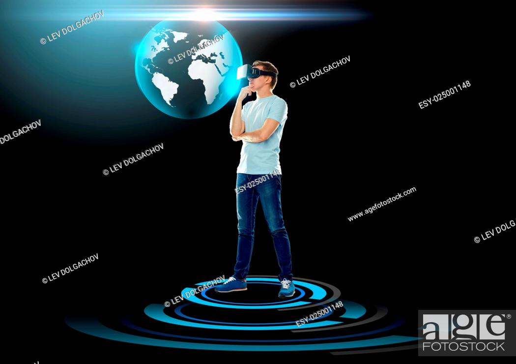 Stock Photo: 3d technology, augmented reality, gaming, cyberspace and people concept - happy young man with virtual reality headset or 3d glasses and looking at earth globe.