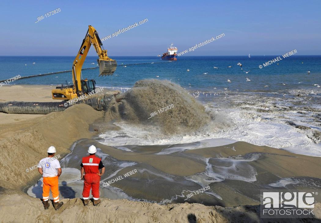 Stock Photo: Dredger pumping sand through a hose onto a beach for beach nourishment or beach replenishment, Platja de Barceloneta, Barcelona, Catalonia, Spain, Europe.