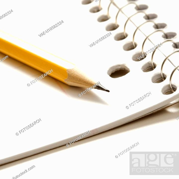 Stock Photo: Sharp pencil placed on open spiral bound notebook.