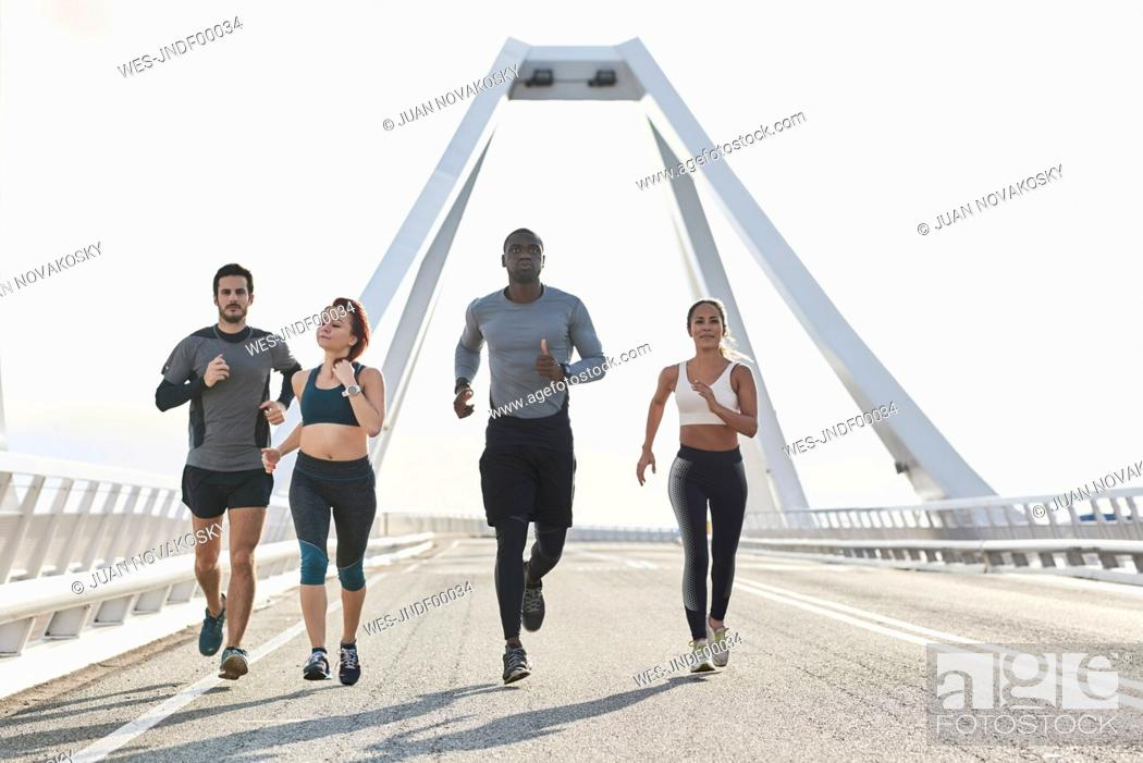 Stock Photo: Group of sportspeople jogging.
