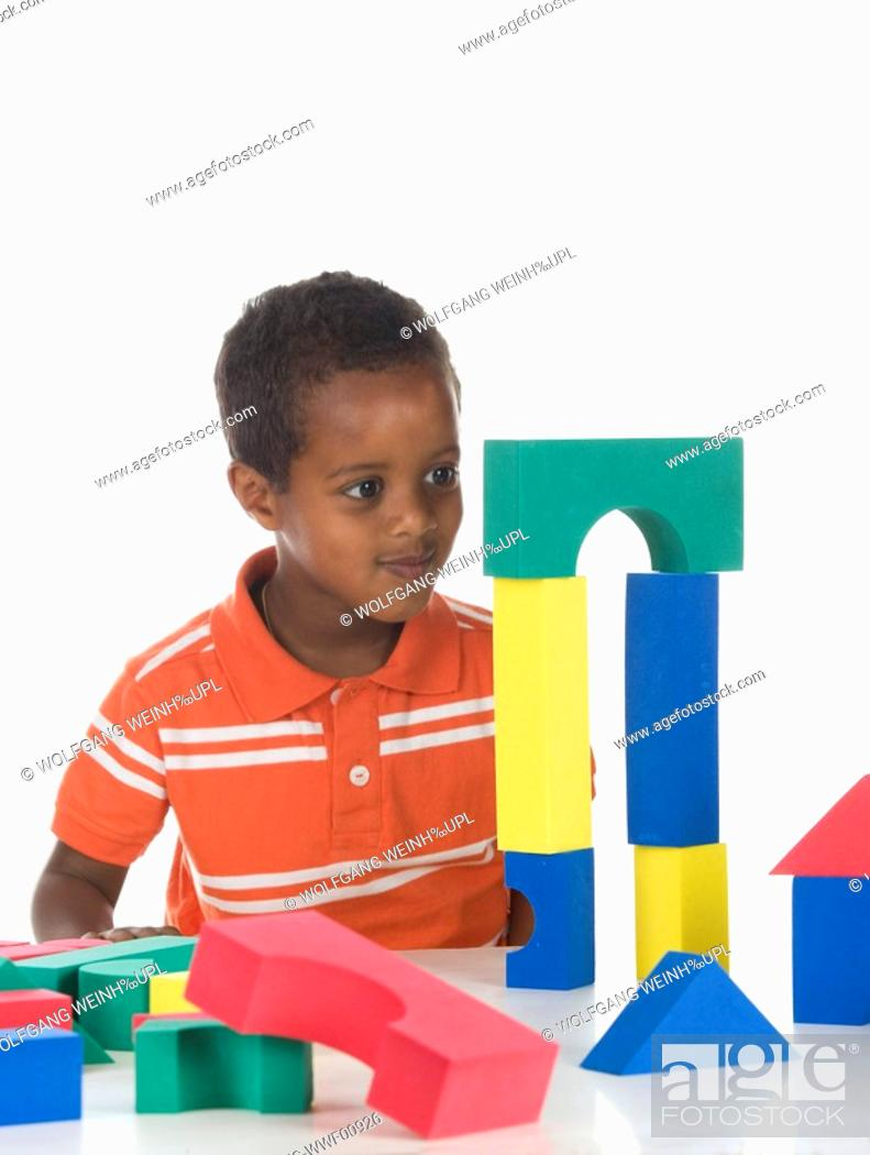 Stock Photo: African boy 3-4 playing with building bricks, portrait.