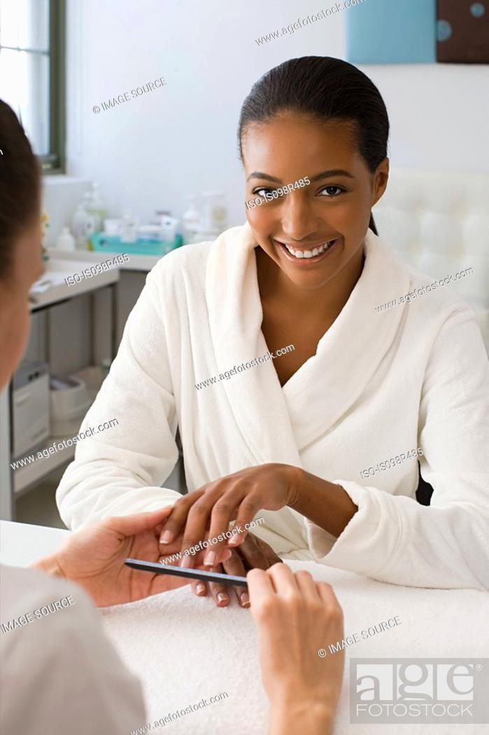 Stock Photo: Woman having a manicure.