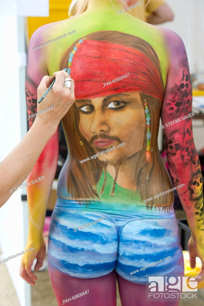 c4ac20b6066b1 Stock Photo - A model presents a creation featuring Johnny Depp as Captain  Jack Sparrow of the 'Pirates of the Caribbean' movie franchise by body  painting ...