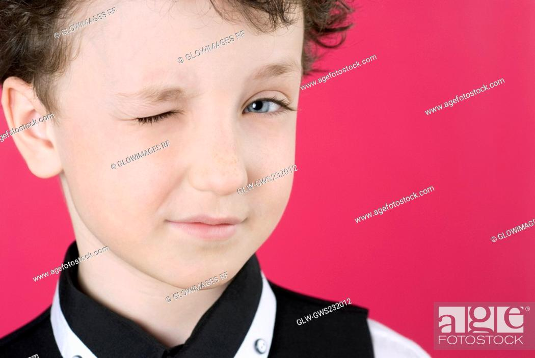 Stock Photo: Close-up of a boy winking.