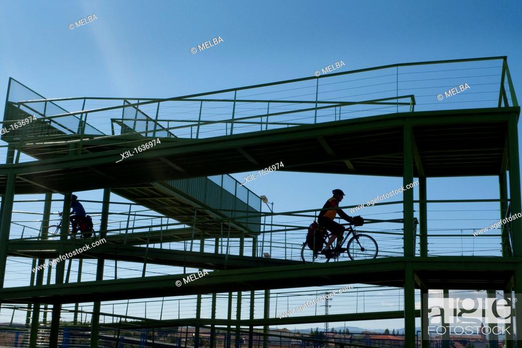 Stock Photo: Cyclists pass railway, Astorga  Leon  Castila-Leon  Spain  Camino de Santiago  The way of St  James.