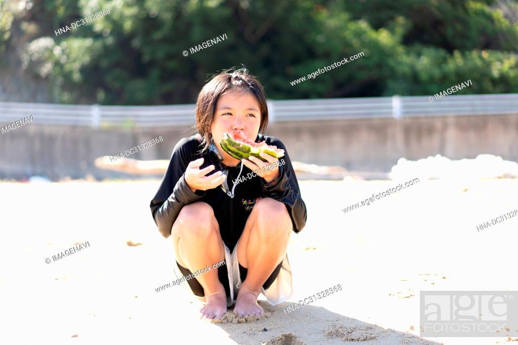 Stock Photo: Girl Eating Watermelon.